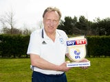 Colin poses with his Championship manager of the month award for March 2018