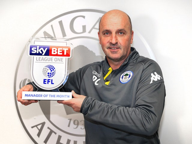 Wigan Athletic manager Paul Cook poses with his League One manager of the month award for March 2018