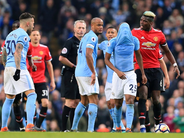 Paul Pogba argues with Fernandinho during the Premier League match between Manchester City and Manchester United on April 7, 2018