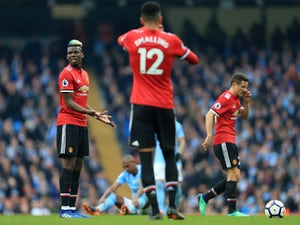 Paul Pogba looks dejected during the Premier League match between Manchester City and Manchester United on April 7, 2018