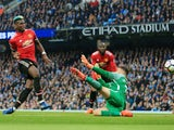 Paul Pogba scores during the game between Manchester City and Manchester United on April 7, 2018
