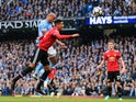 Vincent Kompany opens the scoring during the Premier League match between Manchester City and Manchester United on April 7, 2018