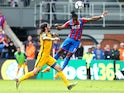 Wilfried Zaha scores Crystal Palace's third goal against Brighton & Hove Albion on April 14, 2018