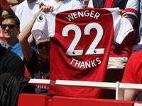 A shirt paying tribute to Arsene Wenger held by a supporter during the Premier League game between Arsenal and West Ham United on April 22, 2018