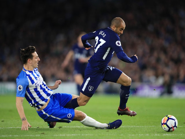 Lewis Dunk of Brighton & Hove Albion fouls Lucas Moura of Tottenham Hotspur on April 17, 2018