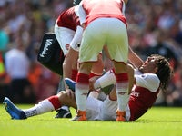 An injured Mohamed Elneny during the Premier League match between Arsenal and West Ham United on April 22, 2018