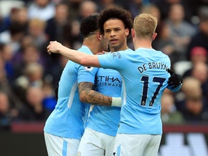 Man City hit four to coast past West Ham