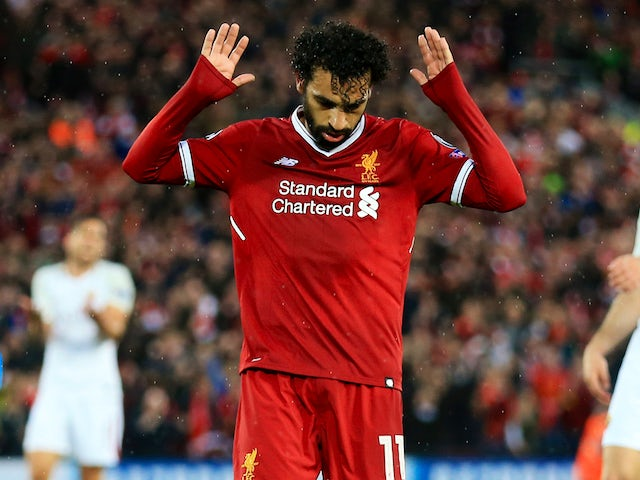 Mohamed Salah celebrates scoring the second during the Champions League semi-final game between Liverpool and Roma on April 24, 2018