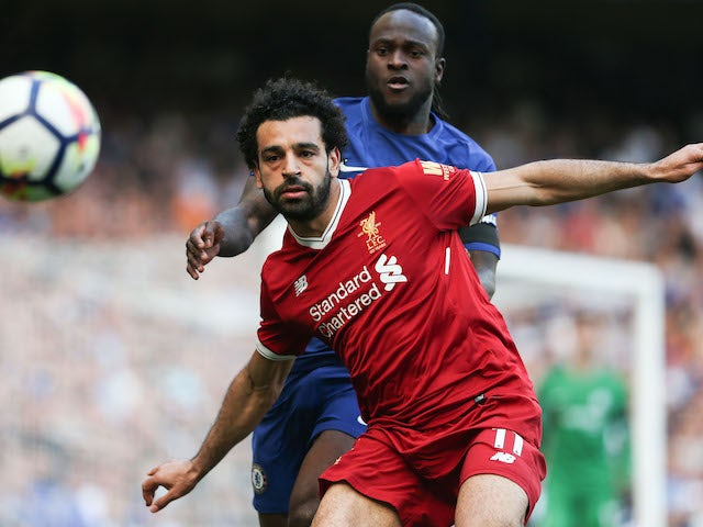 Mohamed Salah and Victor Moses in action during the Premier League game between Chelsea and Liverpool on May 6, 2018