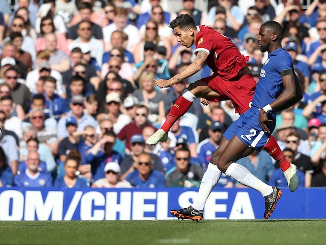Roberto Firmino takes a shot during the Premier League game between Chelsea and Liverpool on May 6, 2018