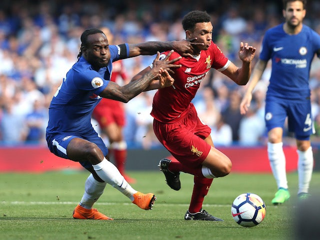 Victor Moses battles with Trent Alexander-Arnold during the Premier League game between Chelsea and Liverpool on May 6, 2018