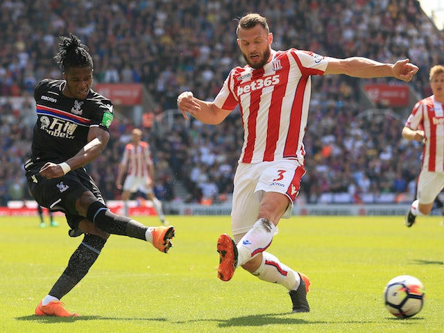 Wilfried Zaha and Erik Pieters in action during the Premier League game between Stoke City and Crystal Palace on May 5, 2018