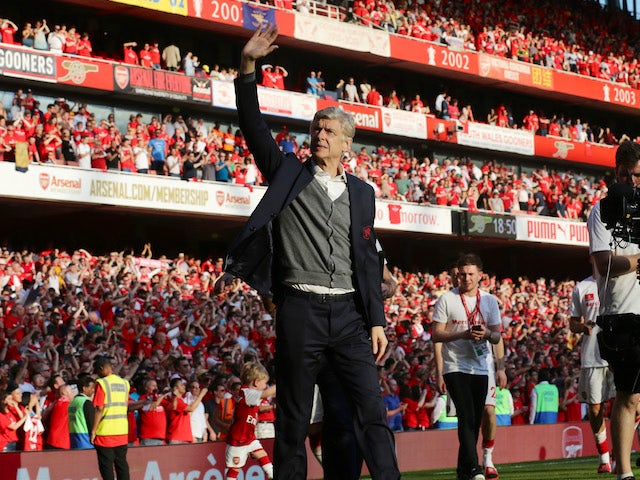 Arsene Wenger bids farewell to fans during the Premier League game between Arsenal and Burnley on May 6, 2018