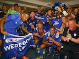 Cardiff City players and staff celebrate promotion to the Premier League on May 6, 2018