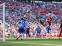 Dejan Lovren scores the second during the Premier League game between Liverpool and Brighton & Hove Albion on May 13, 2018