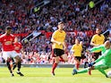 Marcus Rashford scores the opener during the Premier League game between Manchester United and Watford on May 13, 2018
