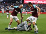 Pablo Zabaleta and Mark Noble of West Ham in action with Phil Jones of Manchester United on May 10, 2018