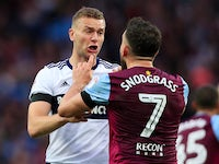 Ben Gibson and Robert Snodgrass argue during the Championship playoff semi-final between Aston Villa and Middlesbrough on May 15, 2018