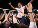 Match-winner Denis Odoi celebrates with fans after the Championship playoff semi-final between Fulham and Derby County on May 14, 2018