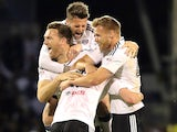 Kevin McDonald, Oliver Norwood, Tomas Kalas and Tim Ream celebrate after the Championship playoff semi-final between Fulham and Derby County on May 14, 2018