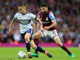 Muhamed Besic and Mile Jedinak in action during the Championship playoff semi-final between Aston Villa and Middlesbrough on May 15, 2018