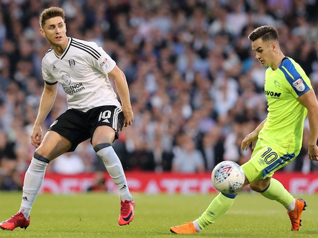 Tom Cairney and Tom Lawrence in action during the Championship playoff semi-final between Fulham and Derby County on May 14, 2018