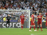 Liverpool's players look dejected after conceding a goal in the Champions League final against Real Madrid