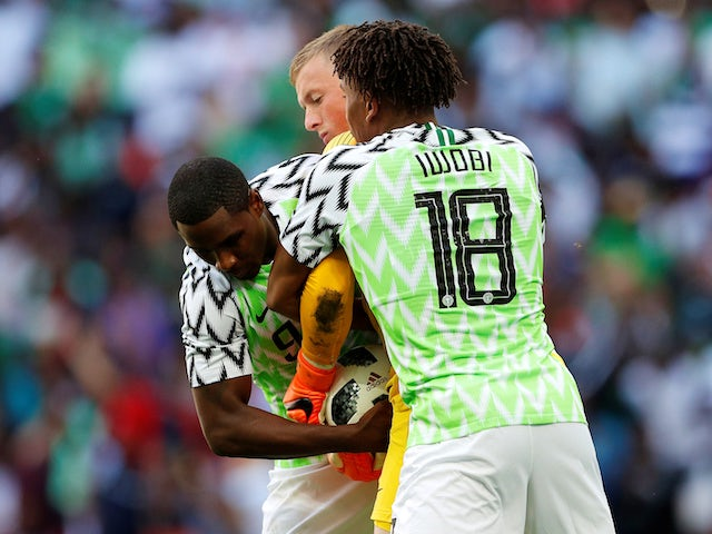 Alex Iwobi and Odion Ighalo team up to wrestle the ball from Jordan Pickford during the international friendly between England and Nigeria at Wembley on June 2, 2018