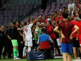 Turkey's Cenk Tosun gestures after being sent off in the friendly against Tunisia on June 1, 2018
