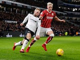 Bristol City's Hordur Magnusson takes on Derby County's Johnny Russell on January 19, 2018