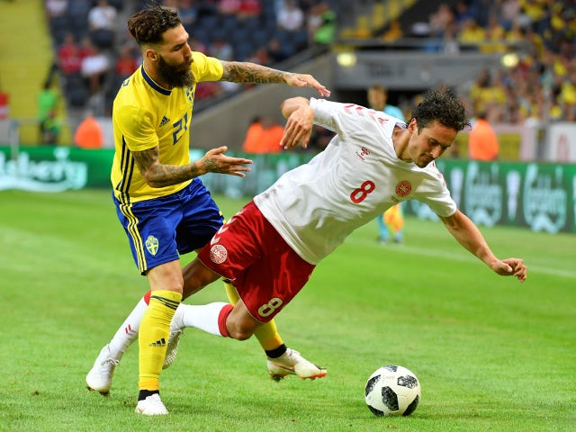Sweden's Jimmy Durmaz brings down Denmark's Thomas Delaney during a friendly on June 2, 2018