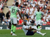 John Obi Mikel takes down Raheem Sterling during the international friendly between England and Nigeria at Wembley on June 2, 2018