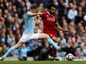 John Stones takes on Mohamed Salah during the Premier League game between Manchester City and Liverpool on September 9, 2017