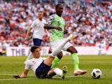 John Stones in action with Odion Ighalo during the international friendly between England and Nigeria at Wembley on June 2, 2018