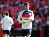 England and Manchester City defender John Stones warms up before an international friendly with Nigeria at Wembley on June 2, 2018