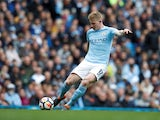 Manchester City midfielder Kevin De Bruyne in action during a Premier League clash with Swansea City at the Etihad Stadium on April 22, 2018