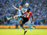 Liam Kelly and Hiram Boateng in action during the League Two playoff final between Exeter City and Coventry City on May 28, 2018