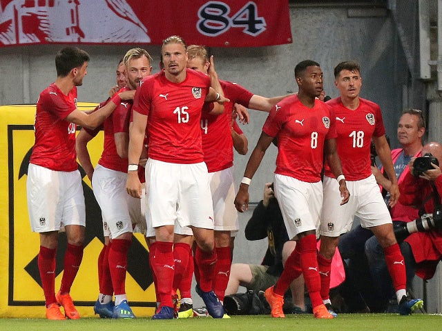 Austria's Martin Hinteregger celebrates scoring their first goal against Germany on June 2, 2018