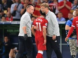 Mohamed Salah receives a hug from Jurgen Klopp after he comes off injured during the Champions League final between Real Madrid and Liverpool on May 26, 2018