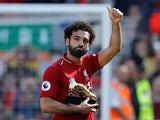 Liverpool's Mohamed Salah holding his golden boot on May 13, 2018