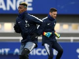 Paul Pogba and Hugo Lloris during a France training session in March 2018