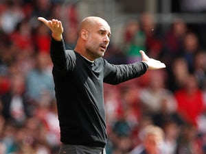 Manchester City manager Pep Guardiola watches on during the Premier League clash with Southampton on May 13, 2018