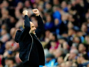 Manchester City manager Pep Guardiola watches on during the Premier League clash with Brighton on May 9, 2018