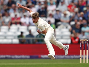 England avert collapse against India