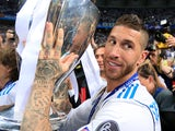 Sergio Ramos poses proudly with the trophy after the Champions League final between Real Madrid and Liverpool on May 26, 2018