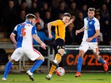 Blackburn Rovers' Grant Hanley and Tommy Spurr in action with Newport County's Aaron Collins on January 18, 2016