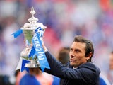 Chelsea boss Antonio Conte poses with the FA Cup on May 19, 2018