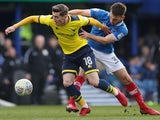 Portsmouth's Ben Close in action with Oxford United's Joe Rothwell on March 25, 2018