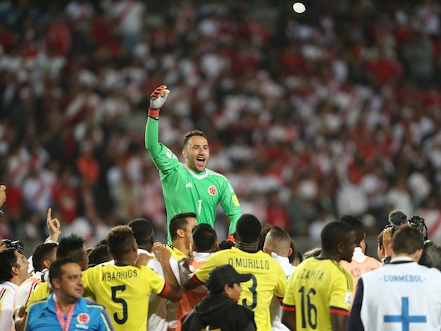 Colombia goalkeeper David Ospina leads the celebrations as his side qualify for the World Cup following a 1-1 draw with Peru