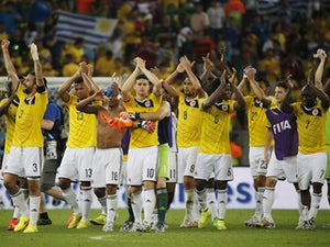 Colombia win to send Poland tumbling